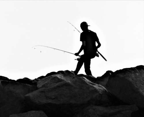 silouette shadow fishing young man