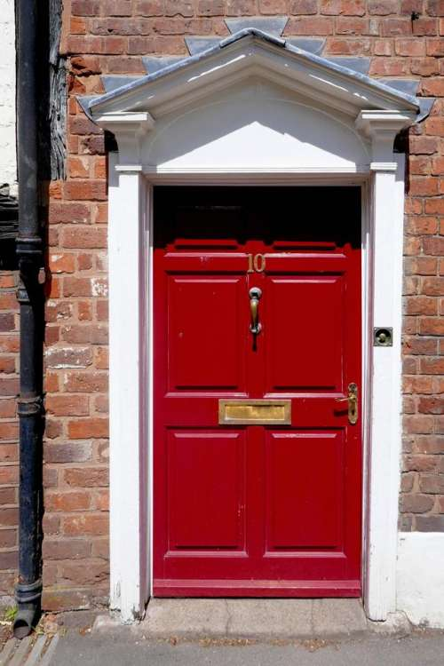 red door house street doorway