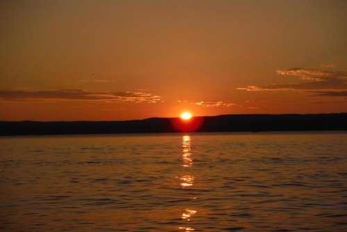 sunrise sunset lake water scenic