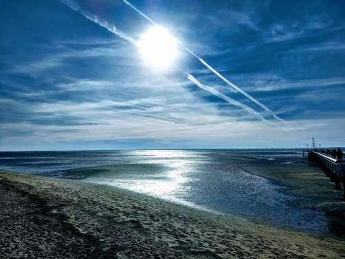 Beach sun sunset spectacular blue sky