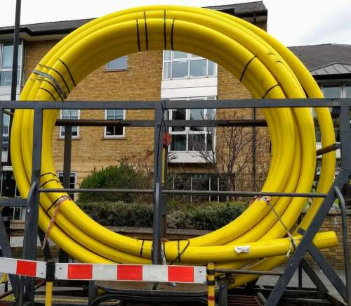 road works yellow pipe rings piping