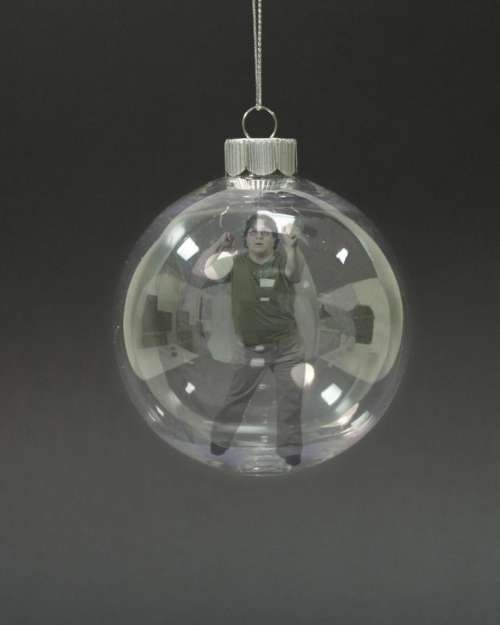 manipulation woman Christmas ornament trapped