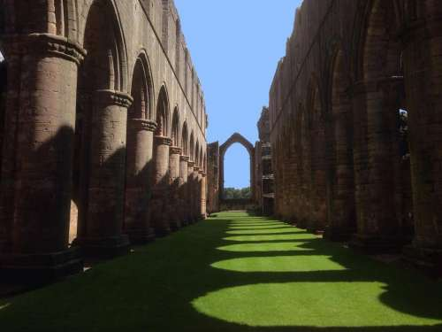 Archway arch architecture shadow lawn