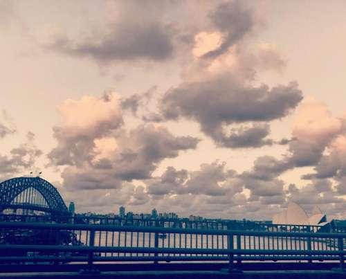 Sydney Harbour fence sky clouds