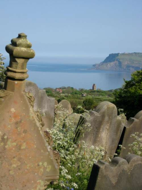 cemetery graves tombstones ocean view