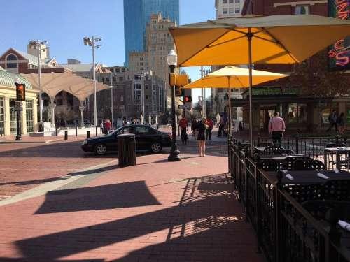 umbrellas downtown cityscape townscape lamp post