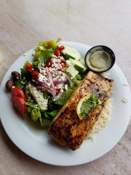 Meal food entree baked salmon Greek salad