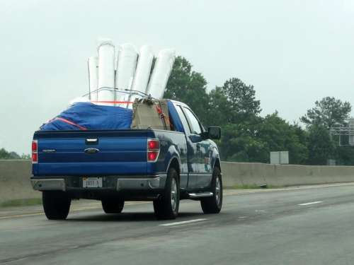 pickup truck blue hauling carpet road
