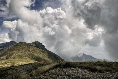 clouds high peak landscape autumn