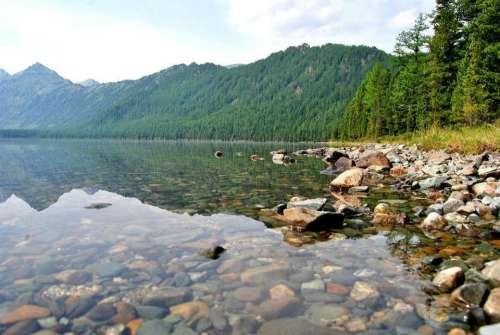 lake shore water stones rocks