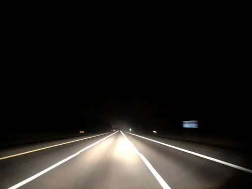 road driving nighttime highway