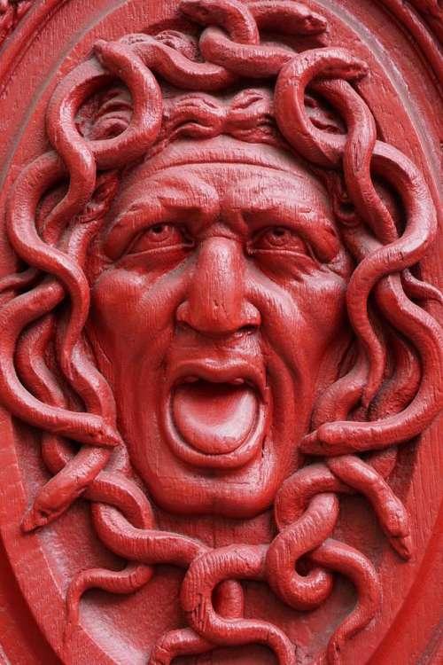 relief art red Medusa Gorgon