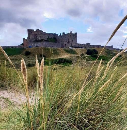 Bamburgh castle sand dunes beach Bamburgh