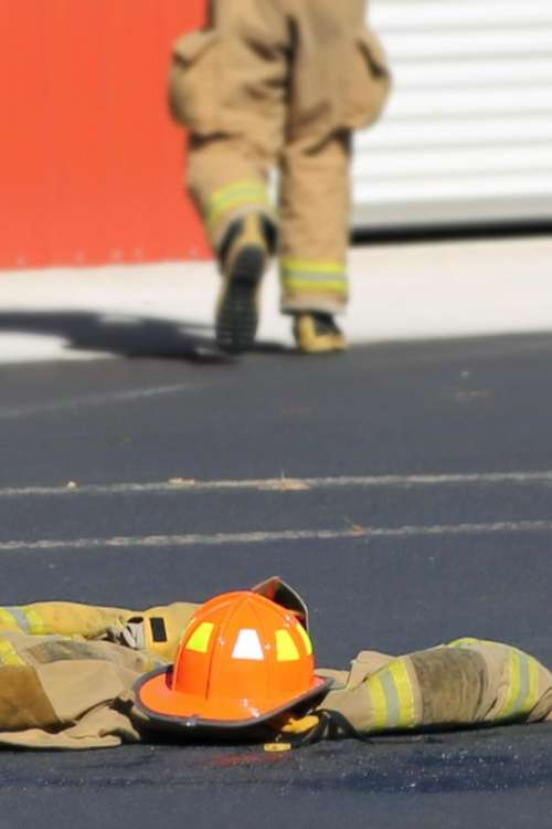 fire fighter uniform walking away helmet turnouts