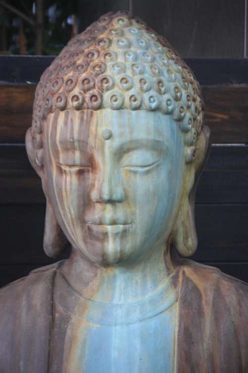 Statue rust Buddha religion religious