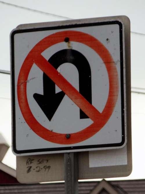 sign No U Turn warning street sign arrow