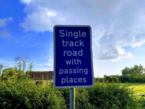 sign road sign no passing places narrow road