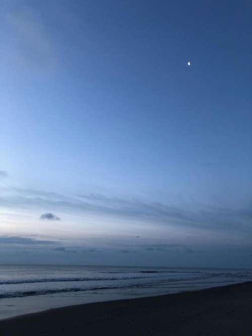 Sky clouds dusk moon beach