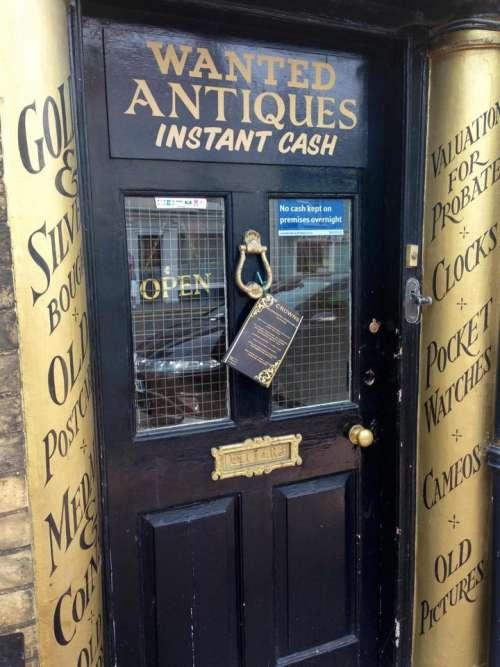 antiques shop signs black gold