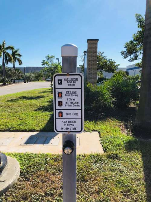 pedestrian sign street sign sign