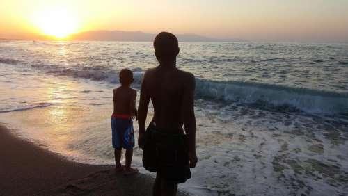 boys beach seashore ocean