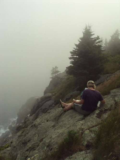 relaxation people seashore cliffs reading