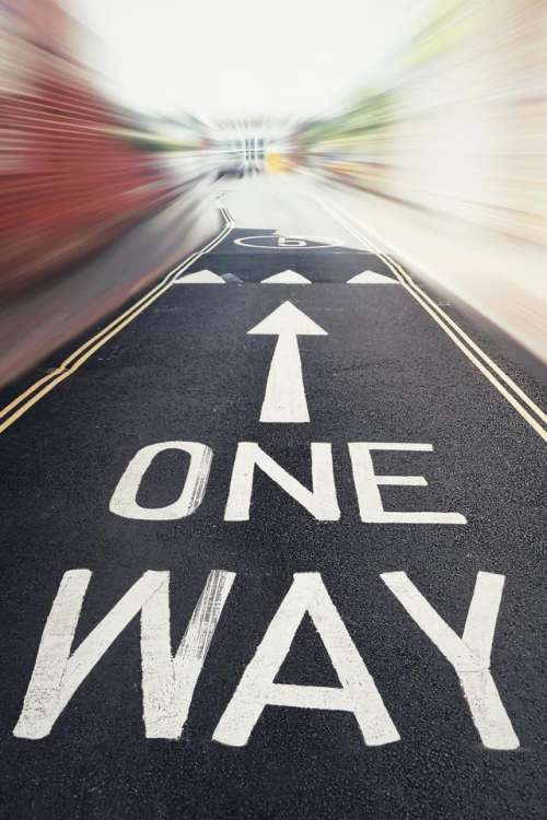 one way road sign tarmac direction