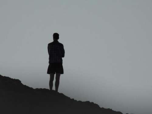 man silhouette shorts dusk