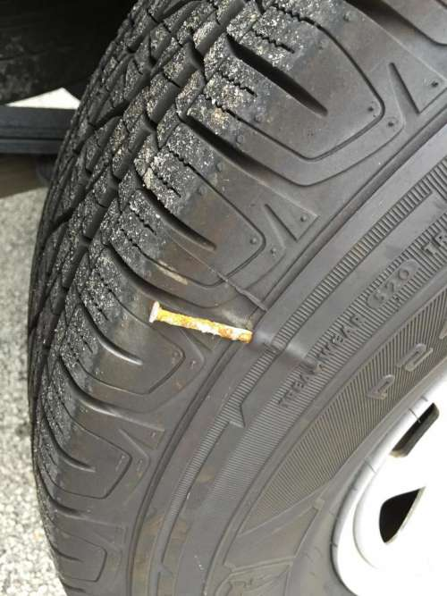 tire flat tire nail in tire