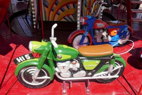 carousel motorbike ride funfair roundabout
