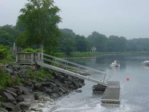 pier dock boat slip water rocky