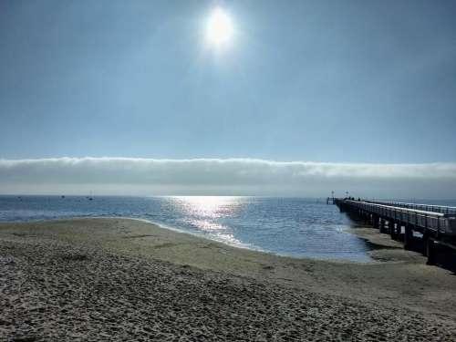 cloud bank beach winter pier jetty