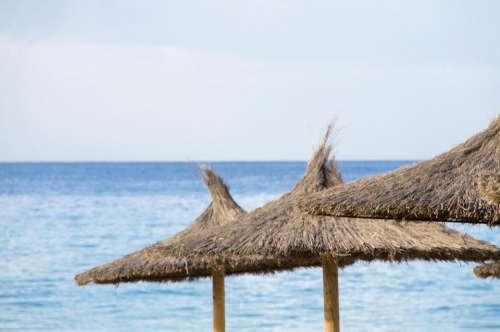 umbrella beach sea thatched tiki
