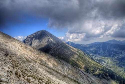 landscape mountain peak sky clouds