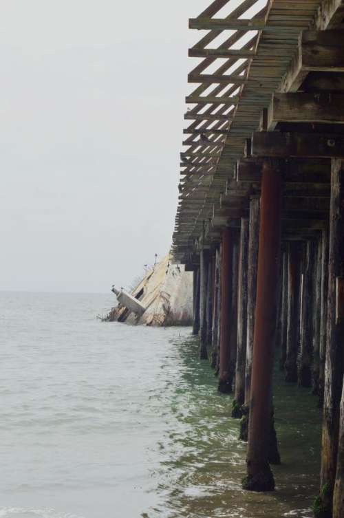 Sunken Concrete Ship pier California ocean