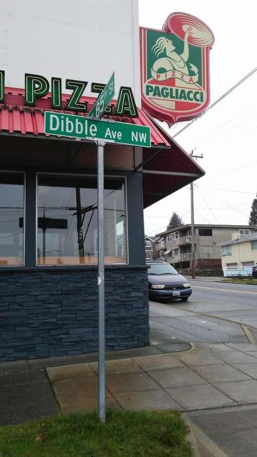 sign street dibble restaurant corner