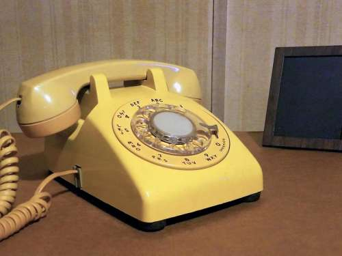 telephone phone landline rotary phone yellow