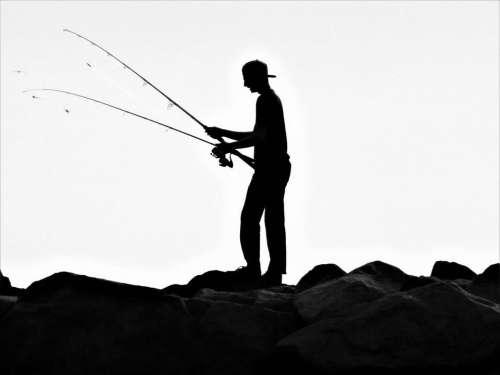 silouette shadow fishing young man