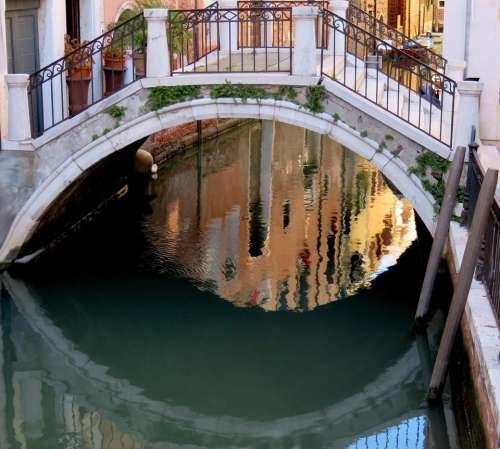 Venice canal bridge reflection water