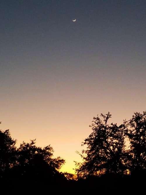 dusk evening sunset moon lunar