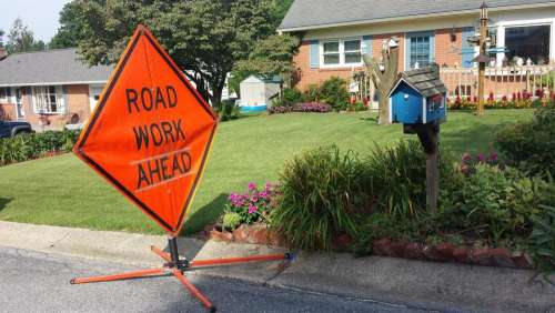 house road work sign mailbox yard