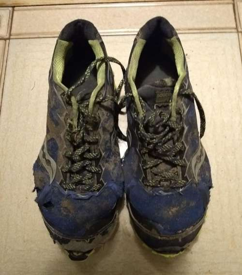 running trail shoes worn out dirty
