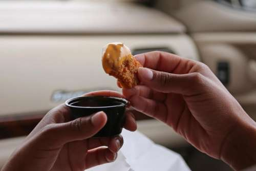 African-American food snack chicken nugget meat hands