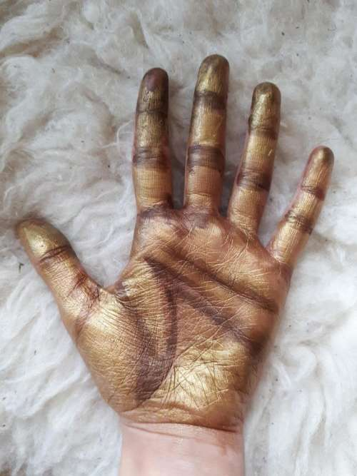 gold hand art inspiration pretty complex body art