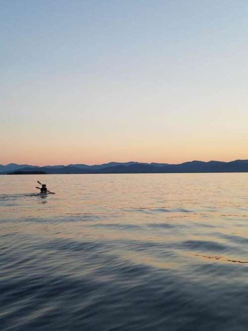 Kayaking kayak lake sunset water