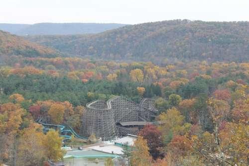 roller coaster amusement park autumn trees colorful trees