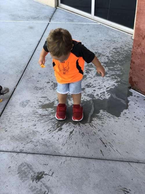 Splash puddle splashing jump toddler