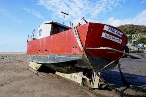 boat beach old moored seaside