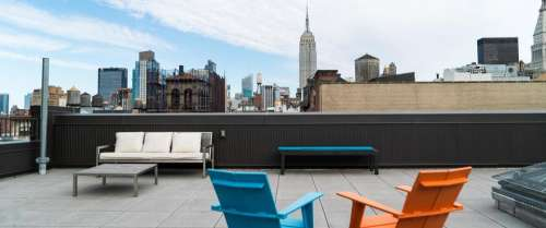 rooftop Manhattan New York City buildings chair