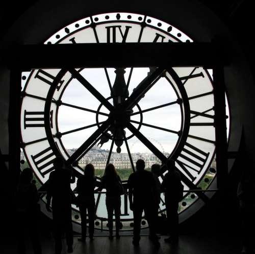 clock time people city dark
